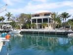Three story home 100 feet deep water dock big pool