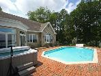 Close in home with pool, dock, hot tub and spacious light filled kitchen.