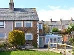 HOLME COTTAGE, coastal cottage with sea views, gardens, ideal base for touring, Penrhynside Llandudno Ref 22175