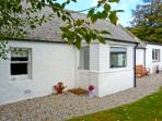 LILAC COTTAGE, stone-built cottage, all ground floor, woodburner, parking, garden, near Strathpeffer, Ref 30495