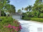 Spacious and private pool home with two Master Suites 10 minutes from the beach!