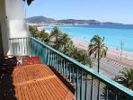 Flat with large sunbathing terrace on beachfront