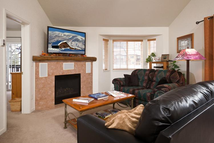 Living Room with vaulted ceiling, 55' TV, surround sound home theater system