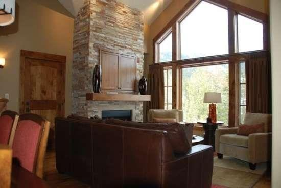 Spacious living room with gas fireplace and views of the mountains