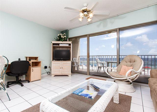 The living room offers a beautiful direct beachfront view of the