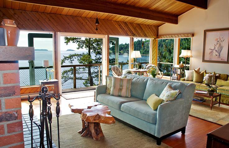 Enter to a Waterfront View w/ a large living room & fireplace. Open concept to kitchen & dining room