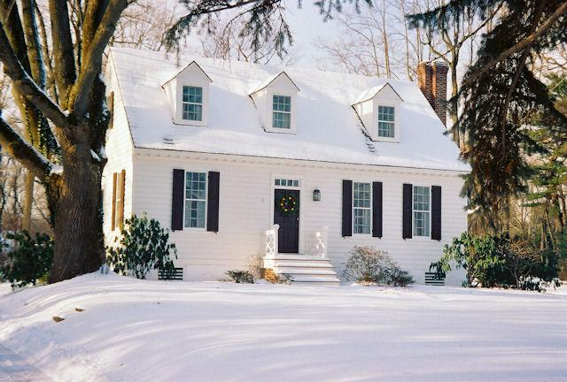 The Cottage in winter under a blanket of snow.
