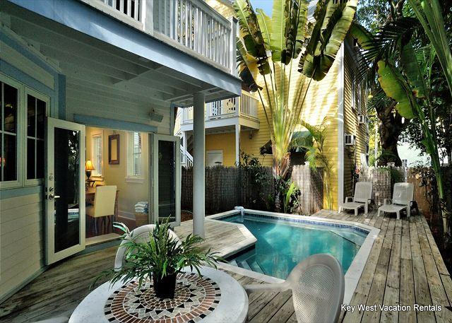 Private Patio and Heated Pool Complete With Loungers and View Into Home