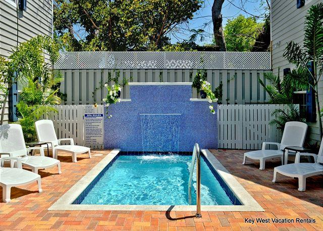 Heated Community Dipping Pool With Waterfall and Lounger Area