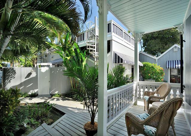 Landscaped Community Courtyard and Unit's Furnished Front Porch Area