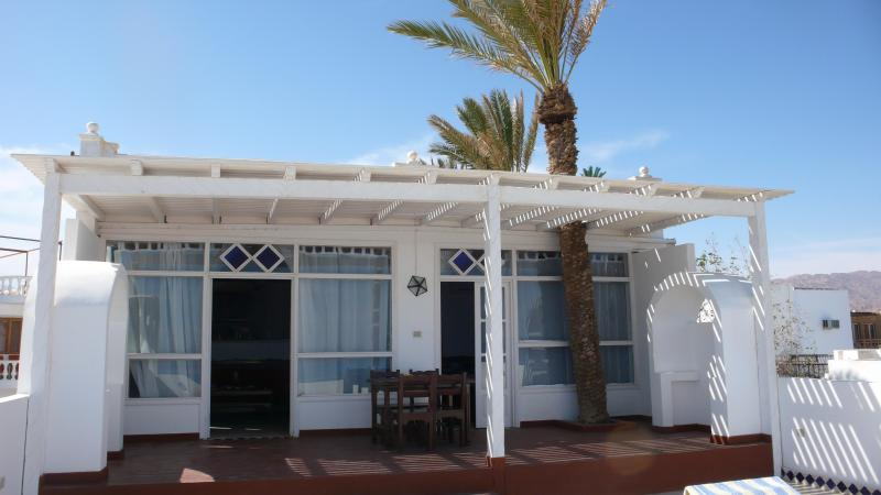 Front of villa opening onto terrace
