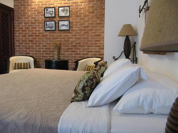 Charming brick wall & lavish king size bed