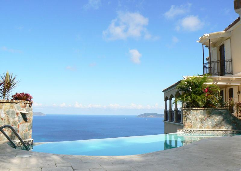 The villa's pool framed by native stone and seashell planters looks north - Areca Peter Bay, St John, US Virgin Islands - Peter Bay - rentals