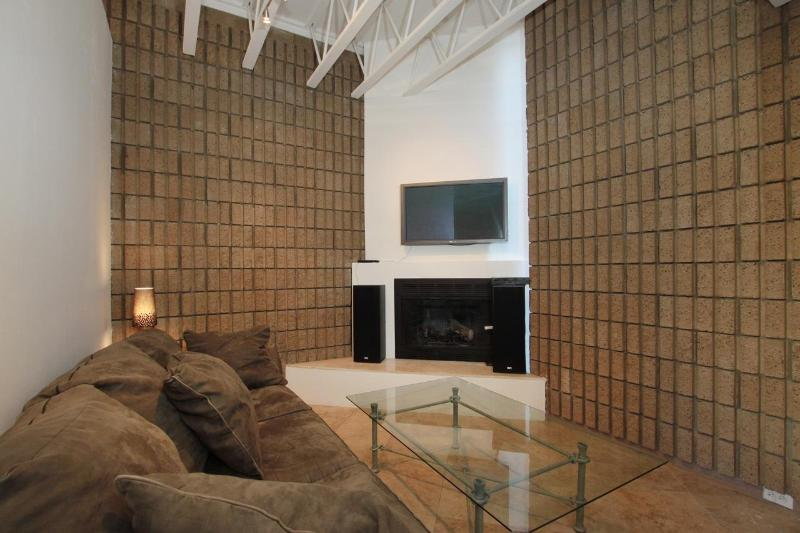shows smal lpart of big open living room