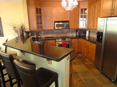 Kitchen with granite and SS appliances