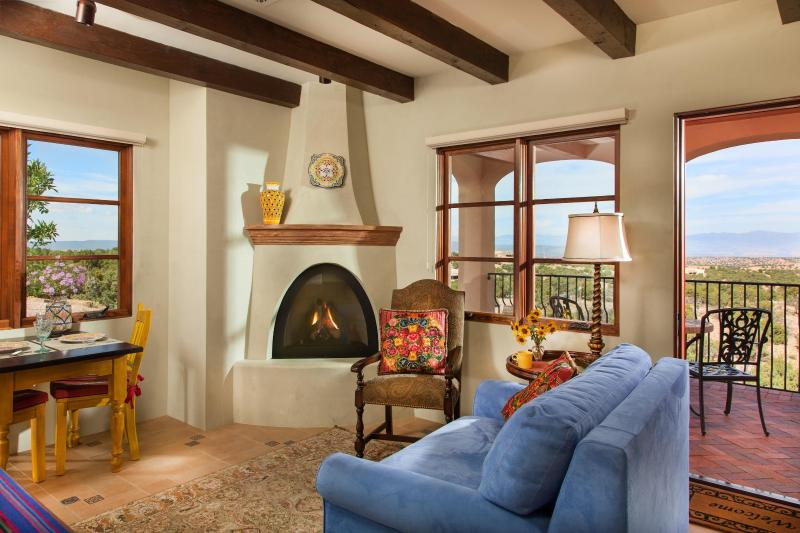 Sitting room, fireplace and entrance patio