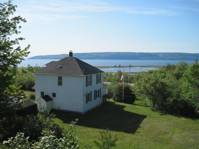 View from hill in back of house toward the ocean - Matheson Farmhouse in Cape Breton, Nova Scotia - Indian Brook - rentals