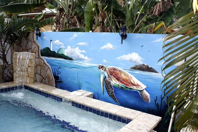 Dip-in pool with cascading waterfall and painted mural back-drop.