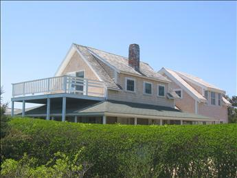 Front of house with original cottage in front with 2nd floor deck & waterview, new section to rear