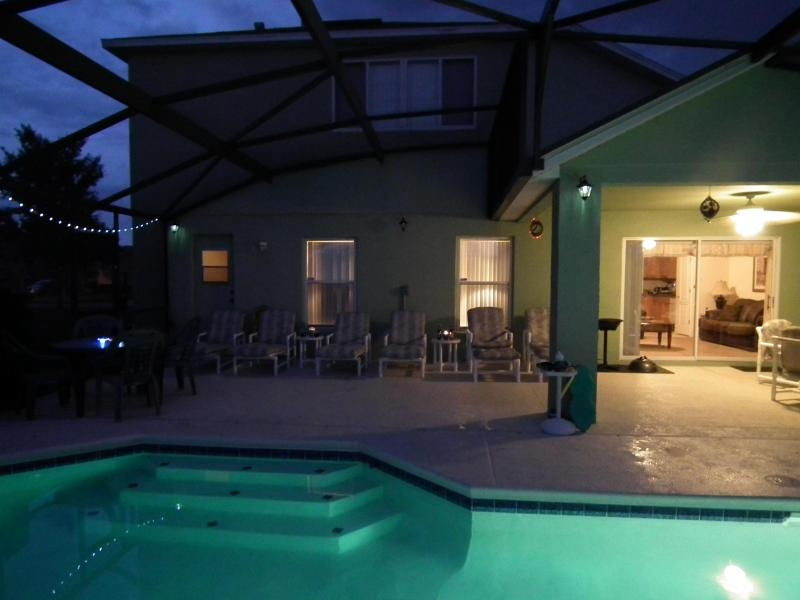 Extended Pool Deck partially covered with luxury cushioned loungers, recliners, chairs & tables
