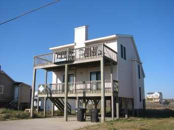 Exterior of this popular home from the Beach Road shows covered and open decks.