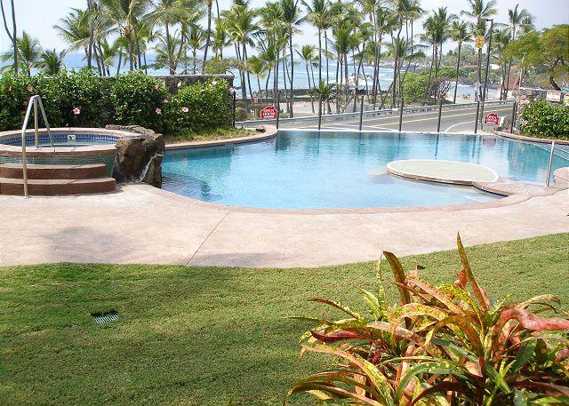 View of the pool and Kahaluu Beach from the lanai, bedroom and l