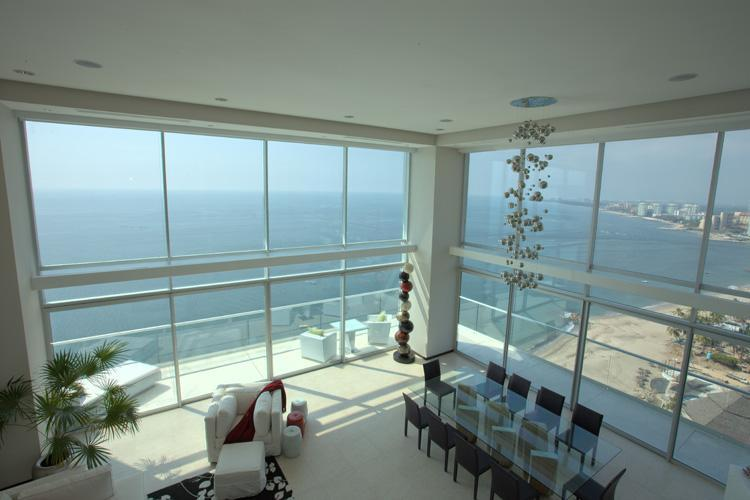 The two-story atrium with sweeping, oceanfront views is the centerpiece of the penthouse
