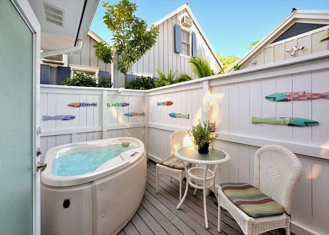 Private Jacuzzi Area With Comfortable Deck Seating and Tropical Decor