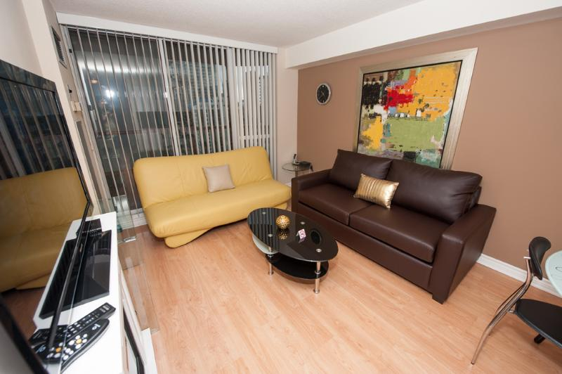 Large Living & Dining room equipped with Plasma LCD TV, Fireplace, Stereo system with Ipod dock