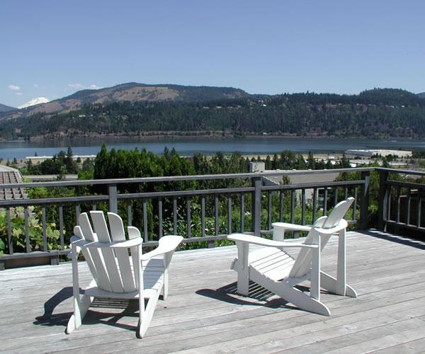 Villa Rosa Deck, adirondack chairs, loung chairs, lg dining table, gas grill