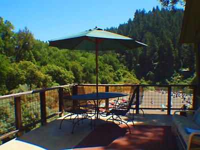 The Rhondavous, Deck with Table and Umbrella Overlooking Riv