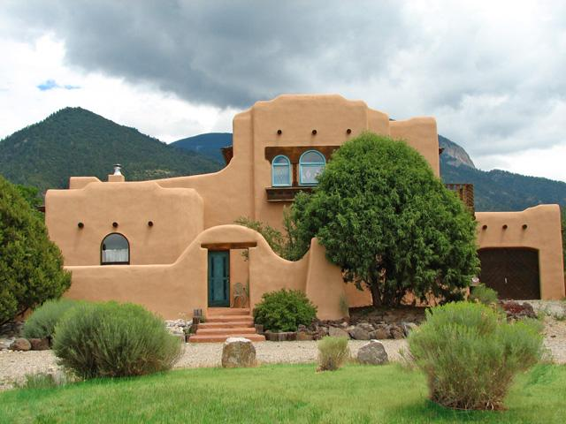 Two story adobe with mountain backdrop and awesome mountain views