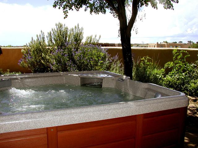 Private Hot Tub with mountain views.  Entire yard enclosed by custom built adobe privacy wall