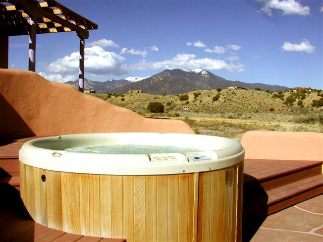 Custom designed scluptured hot tub alcove for privacy allowing panoramic 180 degree views