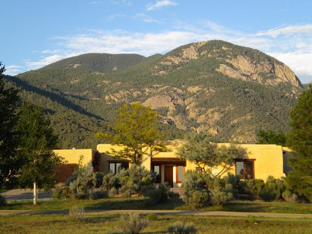 Exterior front view with Taos Mountain background
