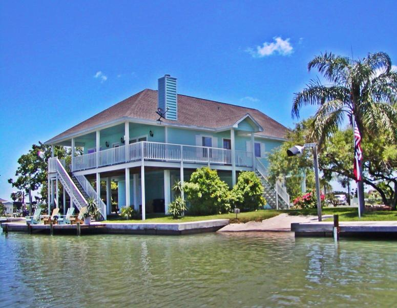 Water front home with lighted dock, boat launch, beautiful furnishings and lots of room for families