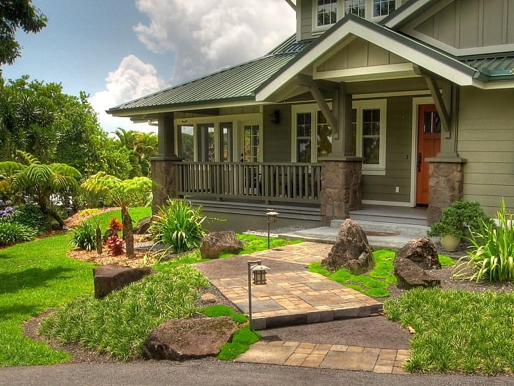 Garden Bungalow with charming cobblestone pavers leading to Craftsman-columned entry