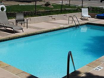 The Outdoor Heated Swimming Pool is Open Seasonally and Just Outside the Condo