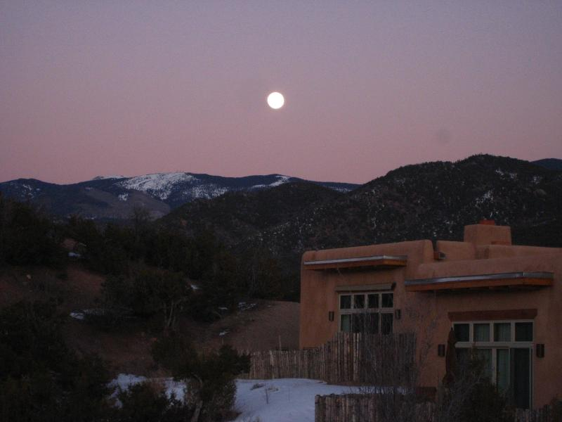 Sunset with Villa in foreground and Mountains behind