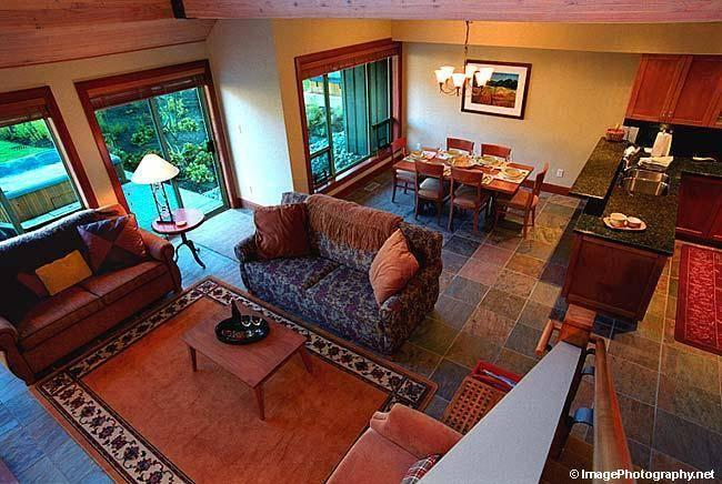 LIVING ROOM: Hemlock Lofted Ceiling (25 ft.), Large Stone Gas Fireplace, Entertainment Center, Heated Slate Floors, and Fabulous Views. Dining Room seats 8 comfortably.