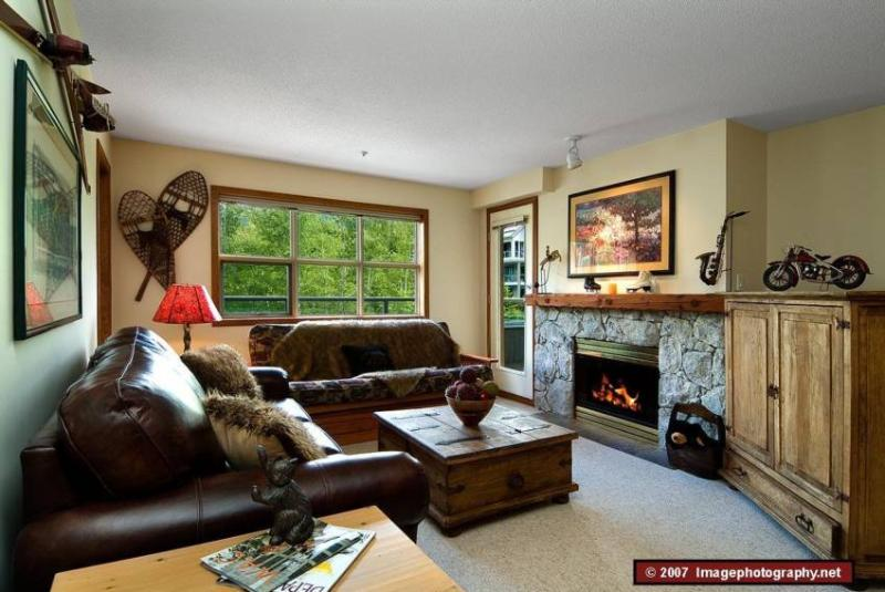 Living Room: Beautiful fireplace that is perfect to snuggle up to after a long day on the slopes.