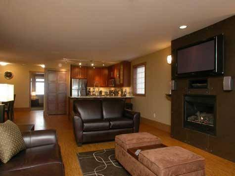 Spacious and comfortable lounge area with inset fireplace and huge wall mounted plasma TV