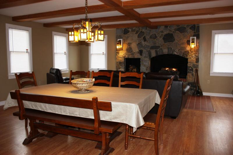 Great Room with dining table and huge fireplace with gas logs