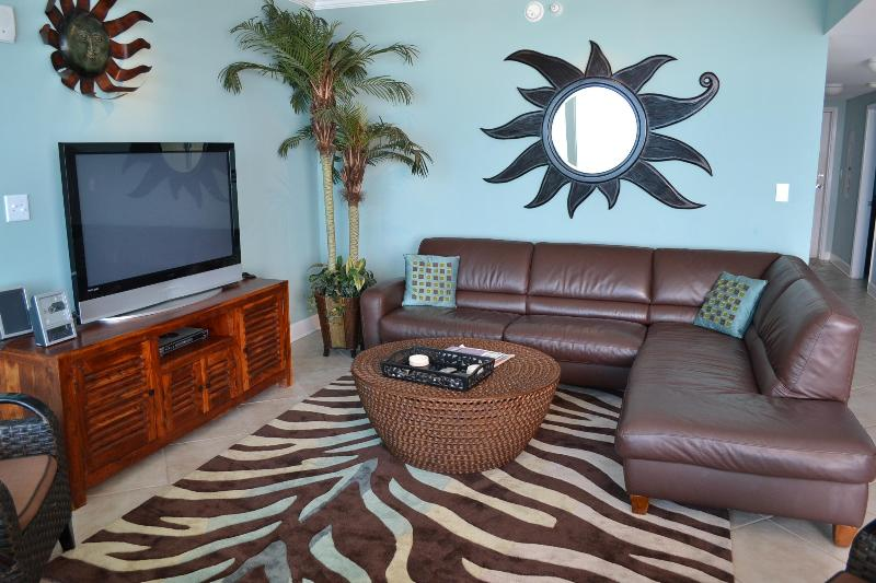 Luxury with Leather sectional, Flat-panel TVs, Caribbean-colored walls