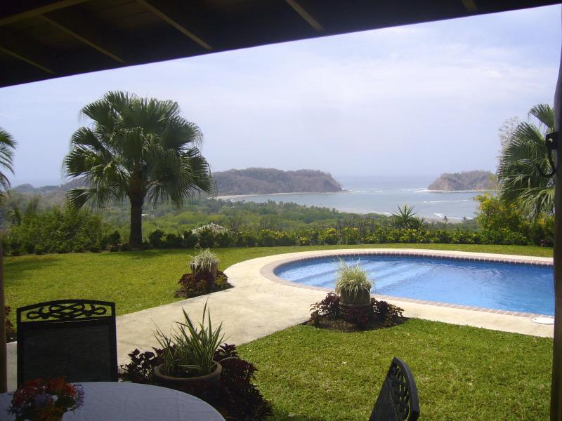 Wake to this master bedroom view of the east end of Playa Samara and Isla Chora!