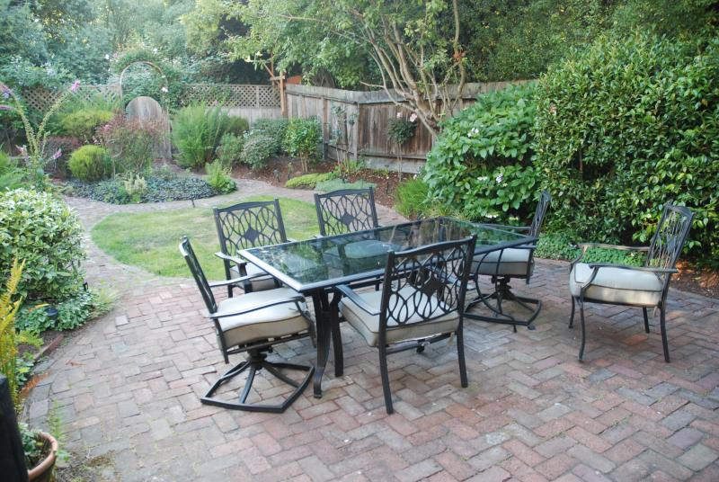 Garden table and chairs allow for great family dinners outdoors.
