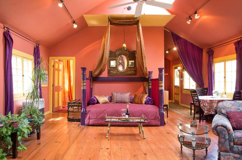 Sultan-style day bed under skylights and a ceiling fan in the great room
