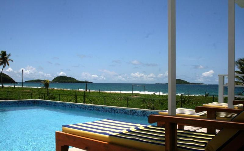 Moonfish sun loungers on pool deck... with fantastic views of the beach and islands beyond!