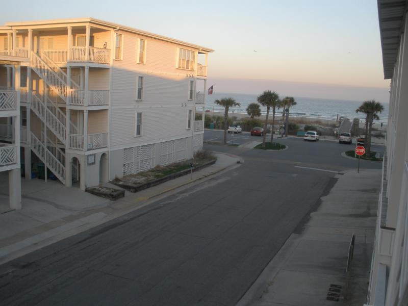 Great View of the Ocean from the Porch, relax  in the swing or comfortable chair with your group