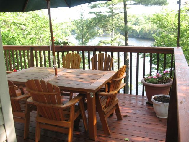 A view off the deck with the cedar outdoor furniture - 3 Bedroom Waterfront Cottage, Parry Sound, Ontario - Parry Sound - rentals